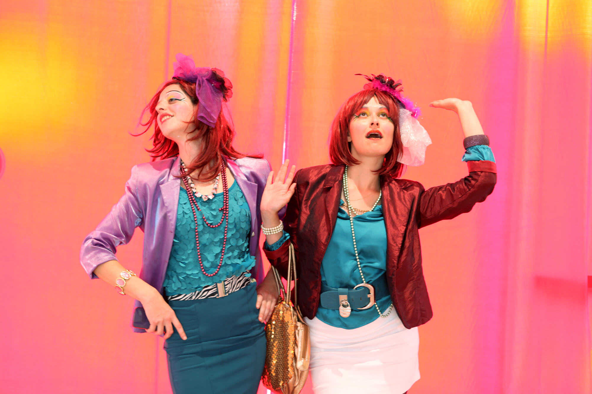 Tow girls dancing and having fun, pink and yellow background, a photo by Shalev Man