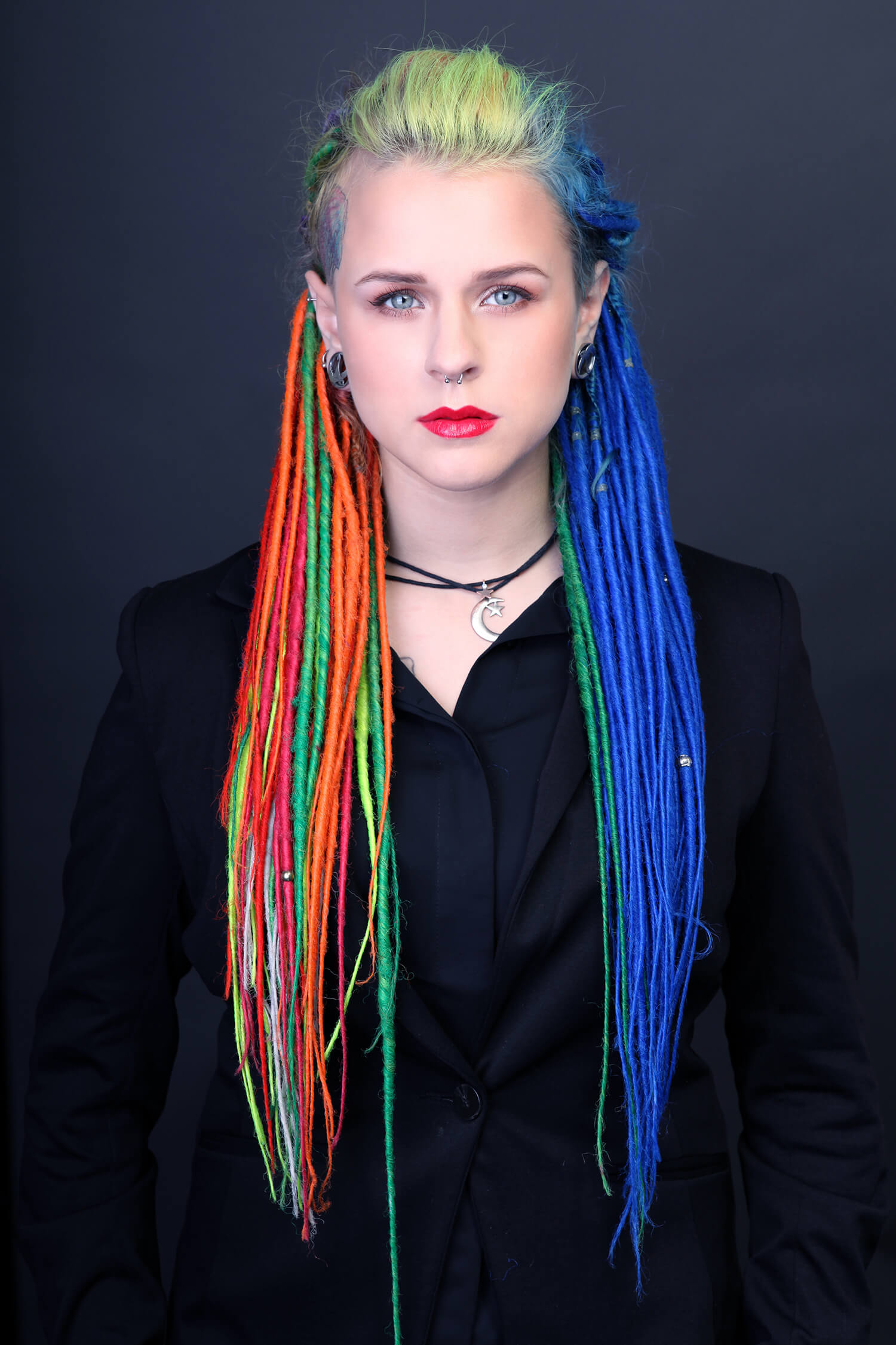 A portrait of a girl with lots of colors in here hair