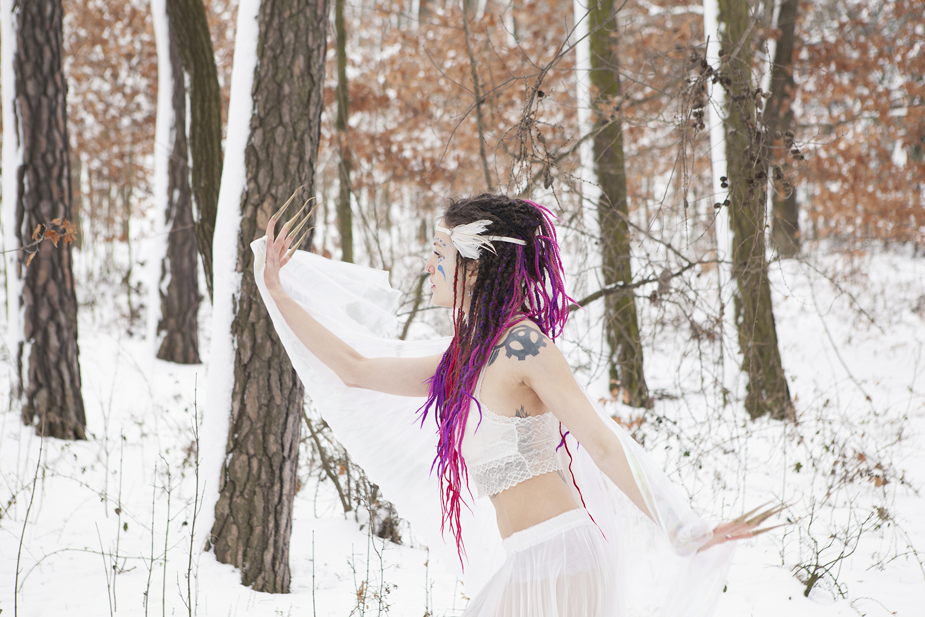 A photo of a purple hair fairy, wearing white, dancing in the forest in the sone
