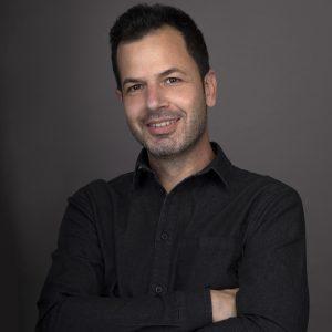 A color portrait of the photographer Shalev Man